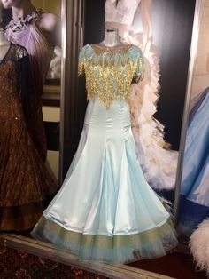 Pale Turquoise and gold gown with layers of soft crinoline