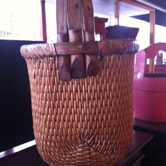 basket at a shop, source and artist unknown