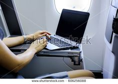 businesswoman working with laptop on airplane