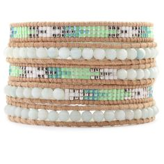 Adorned with stones in a tribal inspired pattern, the Amazonite and Bead Wrap Bracelet on Beige Leather by Chan Luu can add pop to any outfit. Buy online.
