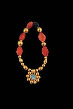 The Fitzwilliam Museum Necklace Fragment with Carnelian beads, 14 gold beads, 1 gold pendant with glass inlay Material(s): Gold, carnelian, glass Date of Object: BC Origin: Colchian Renaissance Jewelry, Medieval Jewelry, Ancient Jewelry, Antique Jewelry, Vintage Jewelry, Coral Jewelry, Jewelry Art, New Jewellery Design, Gold Pendant