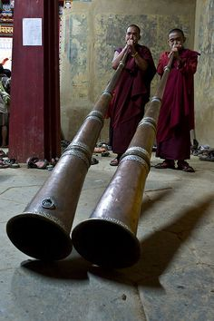 Long horns at Gangtey Monastery, Bhutan, are played for Tibetan Buddhist puja (religious, ceremonial, and monastic practice) worldwide