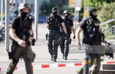 Heavily-armed police stand outside the movie theatre Kinopolis where an armed man was reportedly inside on June 23, 2016 in Viernheim, Germany. According to initial media reports he entered the cinema today at approximately 3pm, fired a shot in the air and barricaded himself inside. Recent reports state that a masked gunman was shot dead by Police after they stormed the cinema complex.