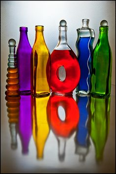 ~~Bottles ~ color wheel by Barry Walthall~~ Bottles And Jars, Glass Bottles, Perfume Bottles, World Of Color, Color Of Life, Rainbow Colors, Rainbow Stuff, Bottle Design, Colored Glass