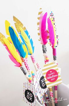 Colorful decorated arrows at a boho Indian Valentine's Day  party! See more party planning ideas at CatchMyParty.com