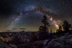 Night Sky at Yosemite Nationwide Park The picture is of the Yosemite national park at night, just before the break of dawn at 3 am. The image shows the heavens filled with the stars and the planets. A few clouds can be seen floating in the horizon and probably a rising sun in the far east of the picture. The Galaxy seen would be the Milky way as earth is located on the outer parts of this big galaxy.