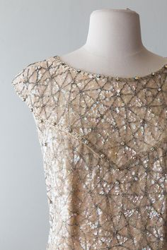 👋 A B O U T Fabulous 1960s fully beaded and sequin covered ivory knit cocktail dress. This iconic 60s cocktail shift is made of fine virgin wool and fully lined in silk. There is no longer a label, but I would assume this was made in Hong Kong during the 60s. Zips up the back with