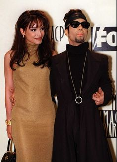 "The Artist Formerly Known as Prince with his wife, Mayte, at the 28th annual NAACP Image Awards ceremony on Feb. 8, 1997, in Pasadena, Calif. The theme for the show is ""Celebration of Family. (Credit: AP / Mark J. Terrill)"