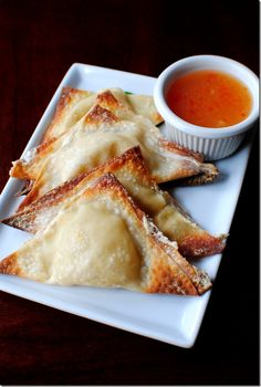 Baked Crab Rangoon. I'm going to use yogurt cheese and Greek yogurt instead of cream cheese & sour cream. Hope these taste as delicious as they look!