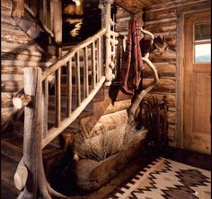 Very organic and simple log home foyer....and I loved the look, until I realized there was either a velvet painting, or a blanket throw hung on the wall....I would suppose that was a gift that had to be displayed!  :)