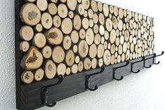 I love these coat racks or hangers with wood slices. They look rustic and contemporary at the same time. Unfortunately I used up all my supply of branches for other projects, so will have to wait for winter before I can chop off some more. Here's how to make your own coat rack with wood slices... http://www.home-dzine.co.za/diy/diy-slice.htm#
