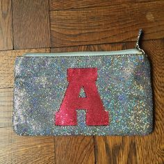 """Vintage pouch Sparkly and glittery. I used this a few times and none of my names start with 'A' but it was too cute to pass up! Zip closure with zip pocket inside. Approx 6"""" x 4"""". Has a loop on the back to attach to another bag or add a fun strap! Accessories"""