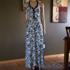 Summer Halter Maxi Dress Black and white print, ties in back, elastic backing, made of a polyester blend, great condition!  ❤️bundles!! Dresses Maxi