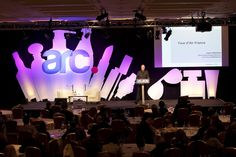 The conference stage at ARC2012 in London with bespoke backdrop