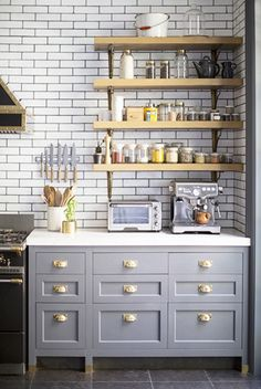 Pale grays with hints of purple. Deep blues with charcoal undertones. Whichever section of the color wheel you skew toward, we can't help but love these gray-blue cabinets. With brass and copper hardware and accessories to add warmth to the space, this kitchen is a dreamy space for all your epicurean dreams.