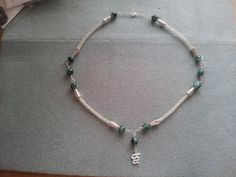 this piece is century Viking weave with fauceted emerald beads and silver snake charm Vikings, Weave, Emerald, Projects To Try, Beaded Necklace, Charmed, Jewellery, Summer, Jewelery