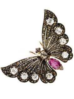 A jewelled gold pendant, Ivan Britzen, Moscow, circa 1890, in the form of a butterfly, the wings set with rose-cut yellow diamonds, the wing tips and thorax with larger diamonds, the abdomen formed with a pear-shaped ruby.