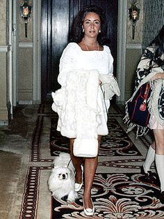 Elizabeth Taylor, who has always been famous for her love of dogs, took her style-coordinated pooch out from the Plaza ...