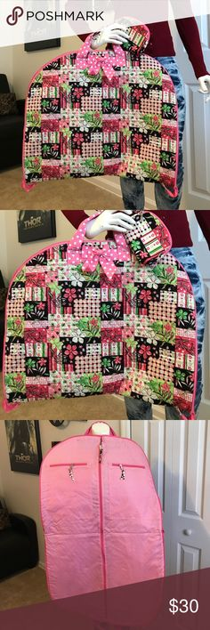 Clothes storage cover with makeup/coin bag 😊 Pink with flowers and with two pink bows Clothes storage cover with makeup/coin bag 😊 with two pockets inside and hook to hold clothes. Like brand new in awesome condition no stains or tears. Little bag is in good condition. When closed 19in H by 23in L when open 38in H by 23in L. The small bag is 5in H by 6.5in L Bags