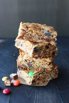 Monster Cookie Bars are filled with oatmeal, peanut butter, chocolate chips, m&ms and leftover Halloween candy! Recipe from Handle The Heat