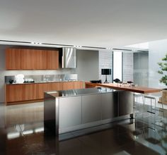 soothing and Luxurious Bellassimo Kitchen Design with Wooden Cabinetry and Countertop and White Kitchen Stools