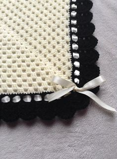 Crochet Granny Stitch Blanket with frilly border This blanket is handmade by me.  Its a crochet granny square blanket with a frilly border and ribbon running through the border.  It can be made in any size and colour.  To enquire, just pop me a message.