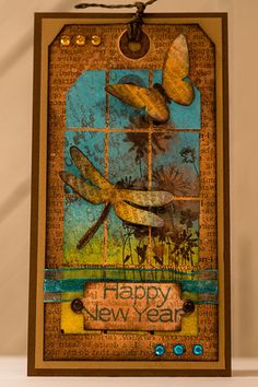 Happy New Year tag handmade by CJ Crafty Designs using Distress Inks and Paints, Stamping, Perfect Pearls, Die Cuts, Bling