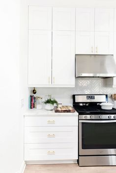 Beautiful kitchen with white cabinets and metallic oven
