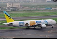Air Do (ex Hokkaido International Airlines) (JP) Boeing 767-33A(ER) JA01HD aircraft, with pictures providing Hokkaido Landscape on the fuselage, rolling at Japan, Tokyo Haneda Int'l Airport. 11/07/2003.