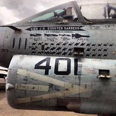 A7 attack aircraft with it's mission accomplishments stenciled on its nose, camel by camel