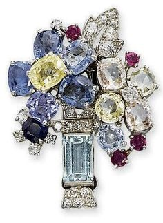 Brooch | Cartier London. Multi-coloured sapphire, ruby and diamond bouquet of flowers to the aquamarine and diamond vase. c. 1940s