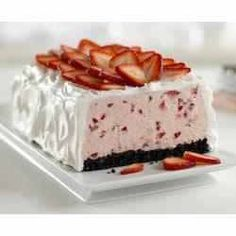 Strawberry Whipped Sensation Ingredients: 4 c. fresh strawberries,1 can sweetened condensed milk,1/4 c. lemon juice,1 tub COOL WHIP, divided,8 OREO cookies, finely chopped. Directions: LINE 8x4-inch loaf pan w/ foil. Mash up 2 c. of strawberries in bowl. Stir in condensed milk, juice, & 2 c. of COOL WHIP; pour into pan.  TOP w/ combined chopped cookies & butter; press into mixture, cover. FREEZE at least 6 hrs. To serve, invert onto plate. Frost w/ COOL WHIP & sliced strawberries. Makes 12