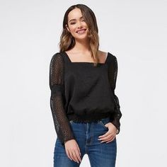 Feminine and flirty, the Dannii Minogue Petites ruched waist peasant top matches back perfectly with skinny pants and heels.*Model wears size 6P
