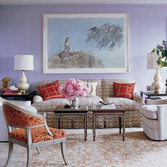 Orange, creams, and lavender living room. By Katie Ridder