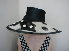 Striking polka dot sinamay hat trimmed in black with  cream covered sinamay buttons.
