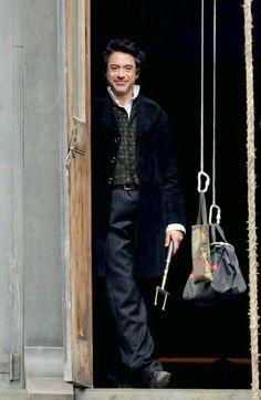 As Sherlock Holmes.