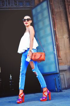 Why not team a white pleated tank with light blue ripped skinny jeans? These two items are very comfortable and will look stunning teamed together. Give a fresh twist to this ensemble by slipping into orange suede heeled sandals. Skinny Jeans Heels, Ripped Jeans, White Jeans, Slim Jeans, Orange Heels, Orange Leather, Fashion Books, Types Of Fashion Styles, Looking For Women