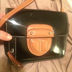 Shoulder Purse Black Beige & Tan with Red Buttons closed has 1 compartment completely open- can fit phone and small wallet. Front part zips and has slots for cards. Minor wear on inside and outside overall good condition. Black is a shiny patent leather material. Strap at be slightly adjusted. Measures about 6x6 Bags Shoulder Bags