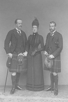 Future George V, Louise, and her husband...Princess Royal Louise's tailored dress does not have a visible trace of a bustle in this group photo. She wears a blusher veil.