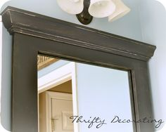 DIY Bathroom Mirror Makeover | just love the difference that it makes....all for very little money!