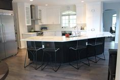 Kitchen remodel design wood cabinets granite backsplash custom home builder house renovations contractor construction interior tiles countertop floors