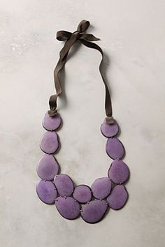 Love this shade of purple, love that they went with brown instead of black for the tie, love the organic shapes of the pieces. Great necklace all around.