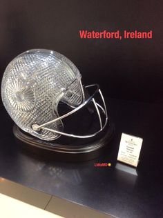 An excellent crystal work of art of an American Football helmet by Waterford in Ireland.