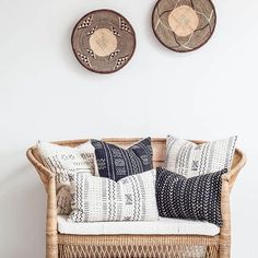 Love how this white wall comes alive with a Malawi cane love seat, some graphic African pillows and those amazing Tonga baskets! 😍 Recreate this look by shopping on our website www.mbare..com  #africandecor #globaldecor #diydecor #bohodecor #roomredo #loveseat #bohohome #jungalowstyle #resortdecor #deckredo #sunroominspo #mbareart #interiordesign #neutrals #livingroomideas