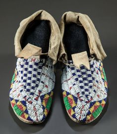 American Indian Art:Beadwork and Quillwork, A PAIR OF SIOUX BEADED HIDE MOCCASINS. c. 1890