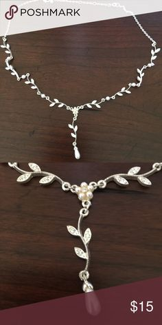 Pearl Necklace Beautiful elegant pearl necklace with faux diamonds. This necklace would be lovely on your wedding day or as an accessory to a little black dress . Jewelry Necklaces