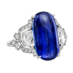 Burmese sapphire and diamond ring, centering on an elongated oval-shaped cabochon-cut sapphire weighing 10.81 carats, in a fancy platinum mounting set with two larger shield-cut diamonds weighing 1.69 total carats and smaller kite-shaped, baguette-cut and round-cut diamond accents weighing 0.54 total carats. Designed by Raymond C. Yard. Circa 2014