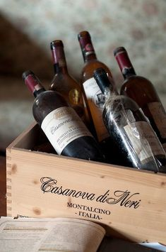 wood crate filled with bottles of Italian wine
