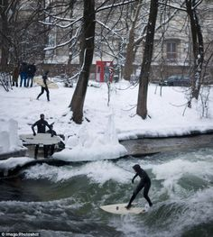 Brrr! In Munich, the river surges over a bulge in its bed, creating a wave just big enough to stand up on