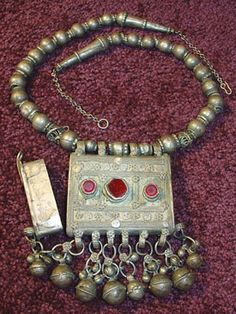 The mergaf pendant is a prayer box which would have been worn as a protective amulet and sometimes would be filled with either a prayer, talismanic object or any item thought to protect the wearer. Typically these mergaf amulets where traditionally strung as necklaces with matching ethnic silver beads.